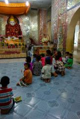 Kids praying inside the giant buddha