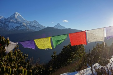 Tibetan flag and snowy mountain = Nepal most common picture?