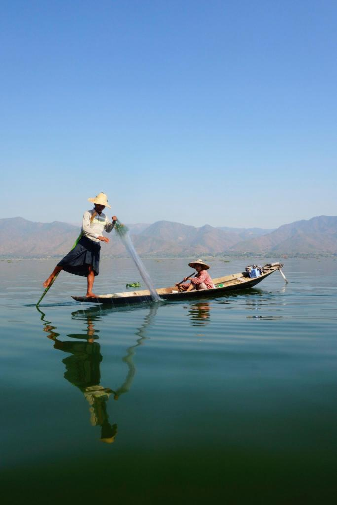 Fisherman paddling with his legs