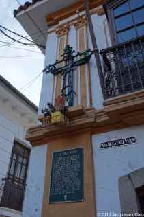 All the houses in this street have at on their facade a cross to push away bad spirits