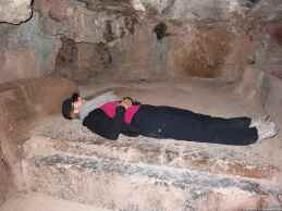 Caroline lying on one of the ritual place inside the holly rock of Q'enqo