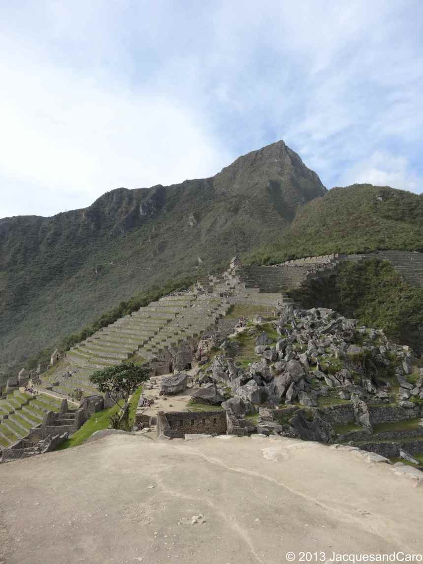 In the background, Machupicchu mountain, then the eastern agricultural sector and at the front the stone reserve to build more...