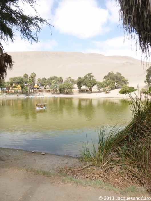 """The small """"lake"""" in the centre of Huacachina… green colour..."""