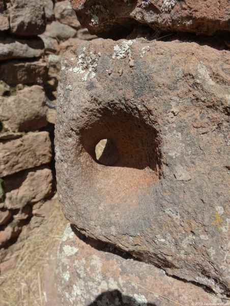 At Pisaq: Hole made inside the stone to lock the door I guess