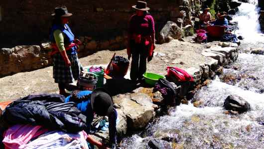 Women working: washing clothes in the river