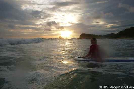 Caroline and her surf in the waves of Playa Madera