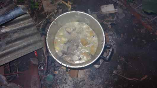 Run-down on the fire… Potatoes, Yuka, and whole fish along with coconut milk and curry