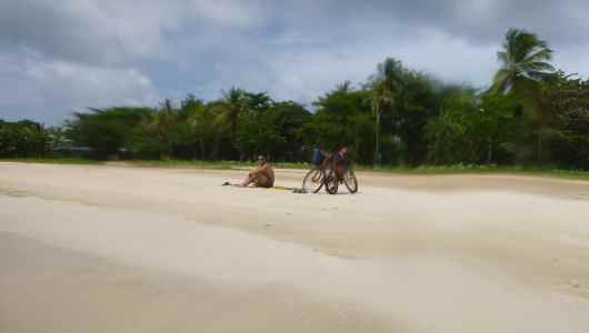 Jacques keeping the bikes while Caro goes snorkelling at South West Bay Beach
