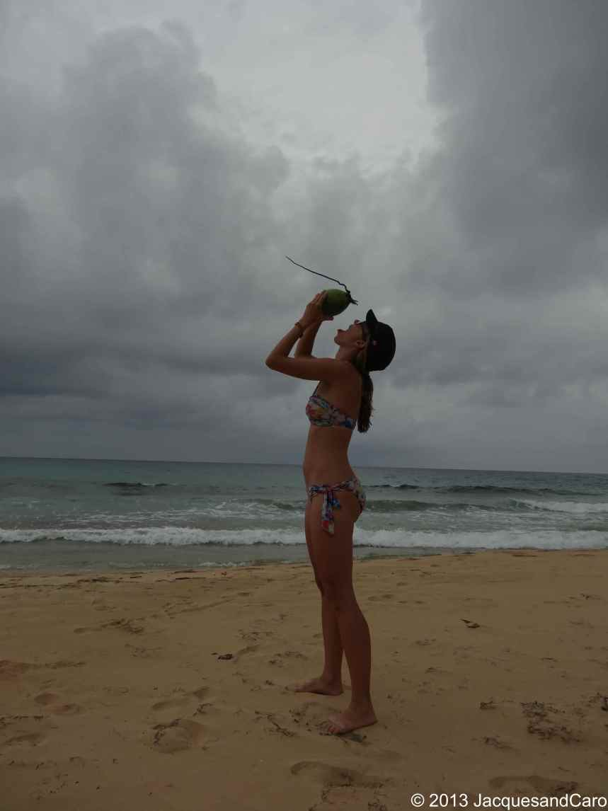 Caroline drinking a coconut on the north part of Long Bay beach
