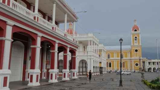 Granada main square: La independencia square with Granda Cathedral in the background