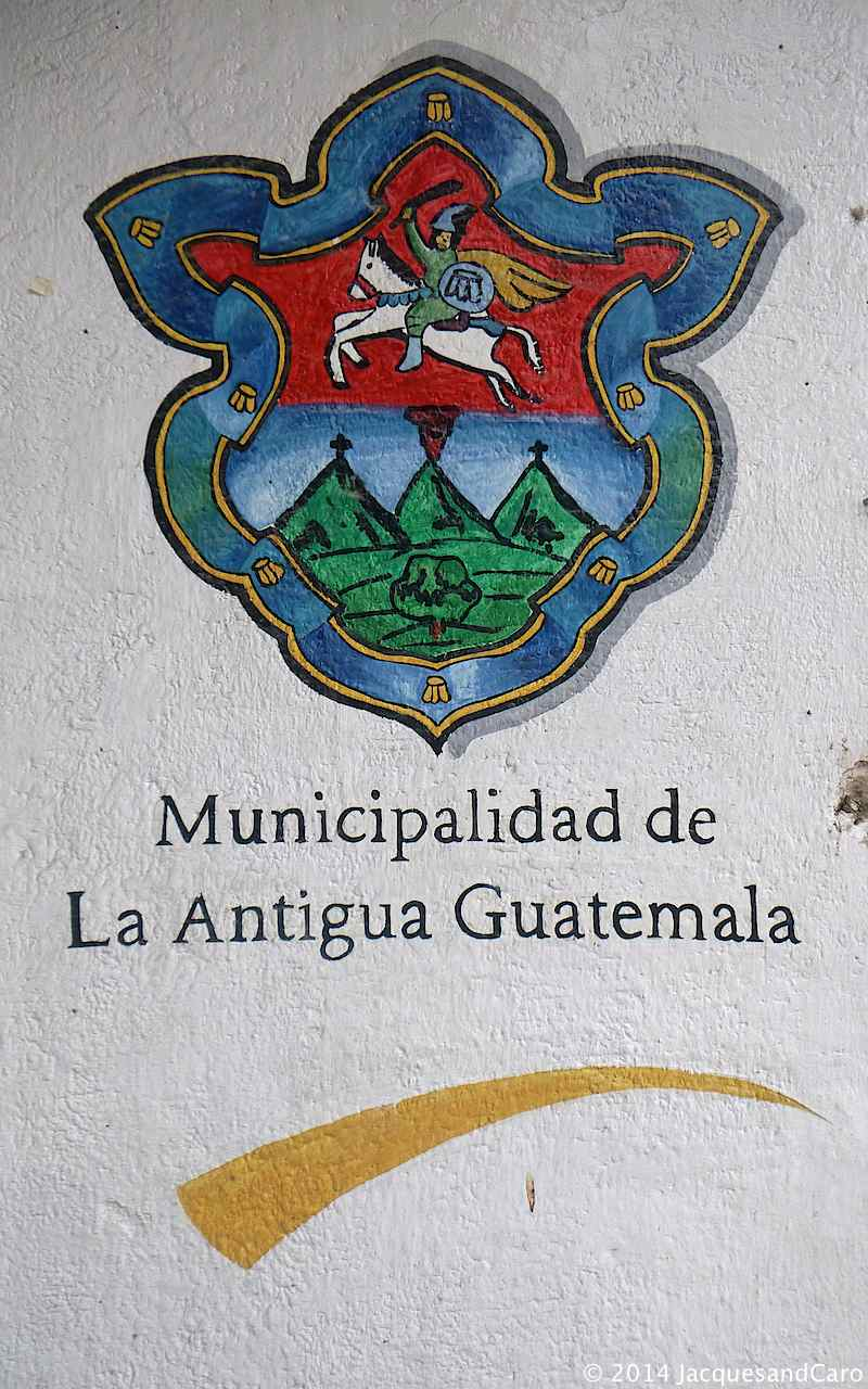 Welcome to Antigua, emblem representing the three volcanos surrounding the city