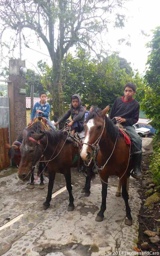 Young kids on their horses at the bottom of the Pacaya volcano.