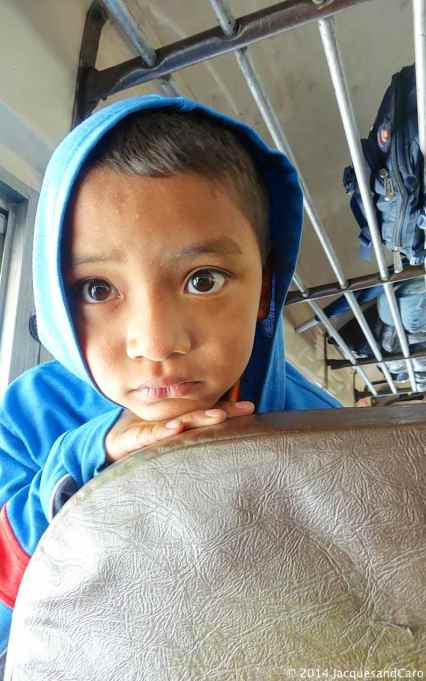 Kid observing us... in the bus between Antigua and Atitlan Lake
